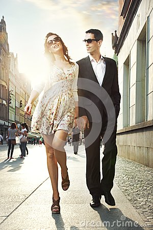 Happy couple in a city center