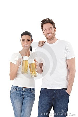 Happy couple clinking glasses laughing Stock Photo