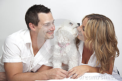 Happy couple with cute pet dog