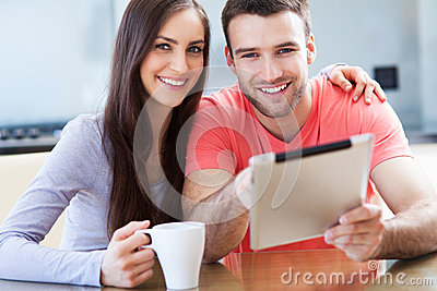 Happy couple with digital tablet