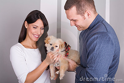 Happy couple and a dog