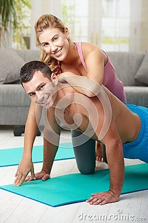 Happy couple doing push ups