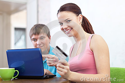 Happy couple doing shopping in internet