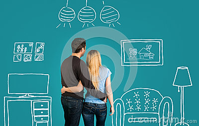 Happy Couple Dreaming Of Their New Home Or Furnishing On Blue Background. Family With Sketch Drawing Of Their Future Flat Interior Stock Photo
