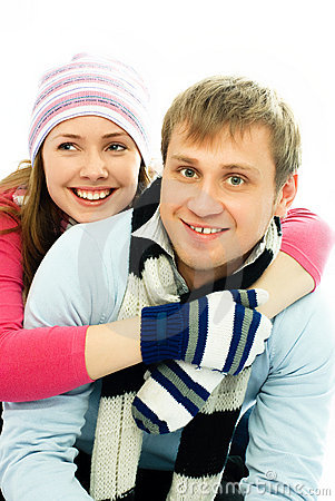Happy couple dressed in winter clothes
