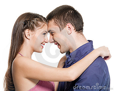 Happy couple embrace look against each other