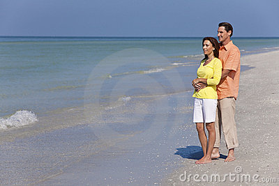 Happy Couple Embracing on An Empty Beach