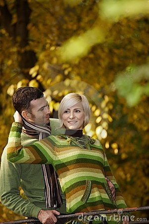 Happy Couple Embracing In Park Stock Photos - Image: 22664633