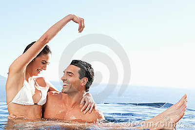 Happy couple enjoying time together in the pool