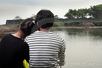 Happy couple facing wall