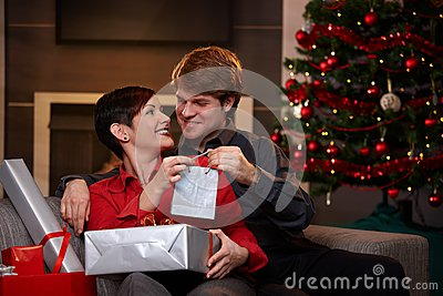 Happy couple giving christmas presents