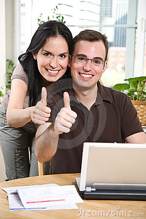 Happy couple giving thumbs up