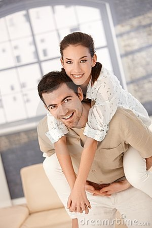 Happy couple having fun at home