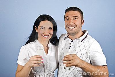 Happy couple healthy with milk glasses