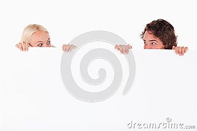 Happy couple hiding