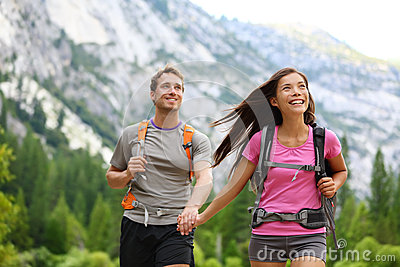 Happy couple of hikers hiking in Yosemite