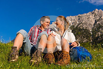 Happy Couple hiking in alp mountains