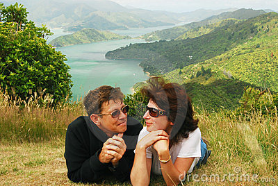 Happy couple at a hill top over Marlborough sound