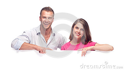 Happy couple holding a blank billboard