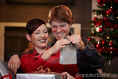 Happy couple holding christmas presents