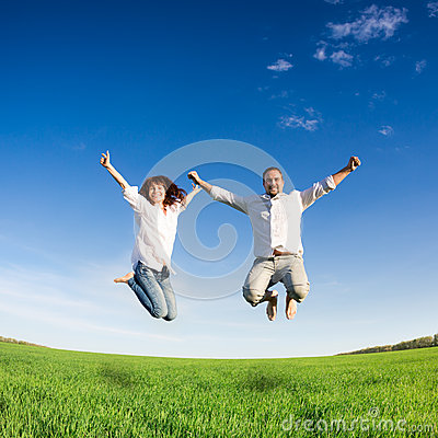 Free Happy Couple Jumping Stock Photography - 31423722