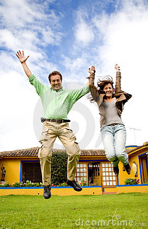 Happy couple jumping of joy