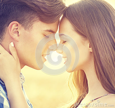 Free Happy Couple Kissing And Hugging Outdoors Royalty Free Stock Photos - 57235468