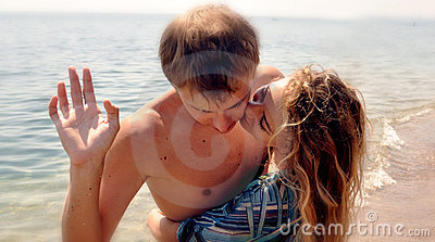 Happy Couple Kissing On The Beach Stock Photos - Image: 20793163