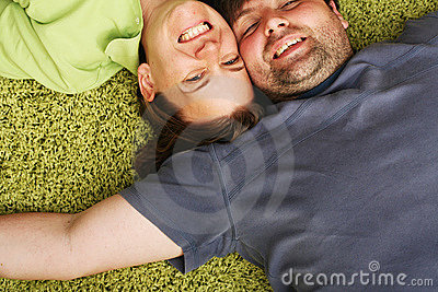 Happy couple laying together
