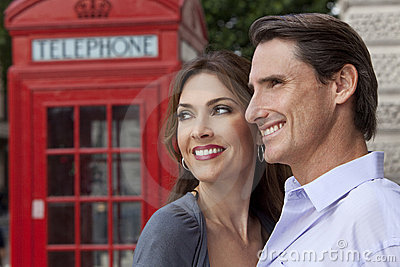 Happy Couple In London With Red Telephone Box