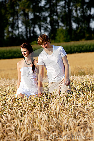 Happy couple in love outdoor in summer on field