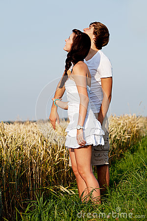 Happy couple in love outdoor in summer on field