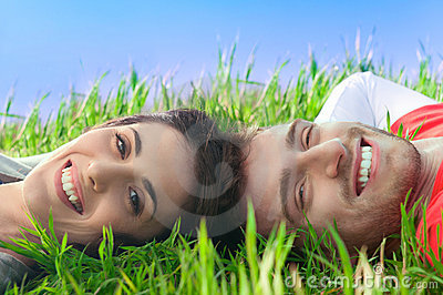 Happy couple lying in the grass