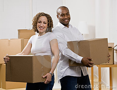 Happy couple moving into new home