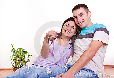 Happy couple in new apartment