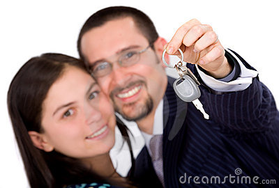 Happy couple with new car keys
