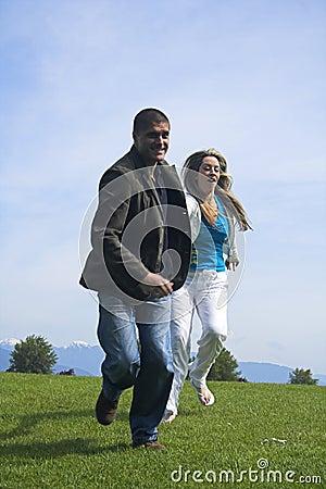 Happy couple outdoor running