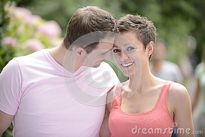 Happy couple outdoors flirting