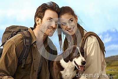 Happy couple outing with dog