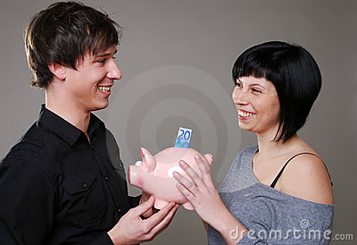 Happy couple with piggybank
