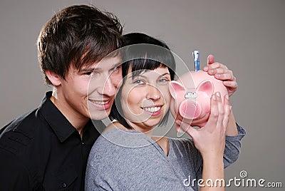 Happy couple with piggybank