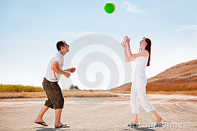 Happy couple playing with a ball