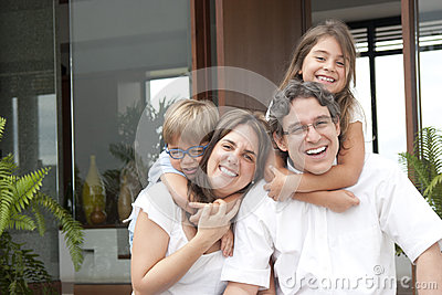 Happy Couple Playing With Two Young Children