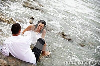 Happy couple portrait - trash the wedding dress