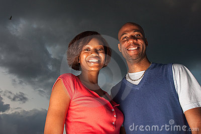Happy couple posing at sunset