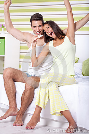Happy  couple with pregnancy test