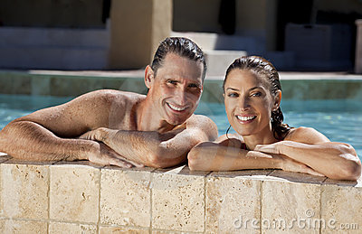 Happy Couple Relaxing In Swimming Pool