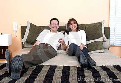 Happy Couple Relaxing and Watching tv