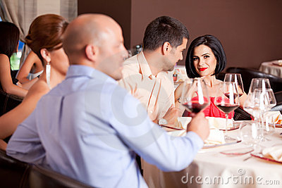 Happy couple at restaurant table talking
