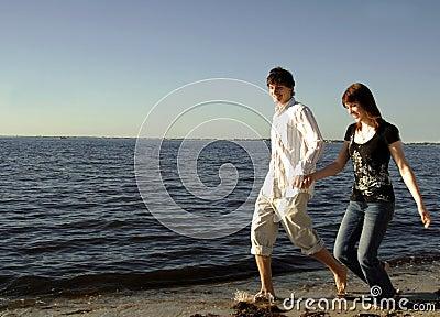 Happy couple running on beach